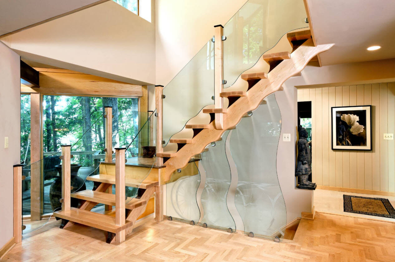 Stairs design with wavy wood and glass handrails