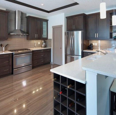 Wine rack and chrome appliances kitchen design