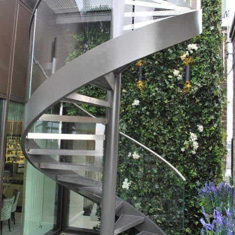 metal spiral staircase and handrail with transparent glass design