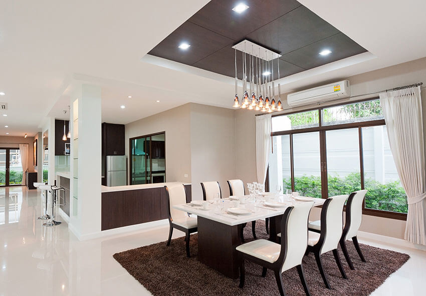 contemporary dining room with rectangular pendant cluster lighting