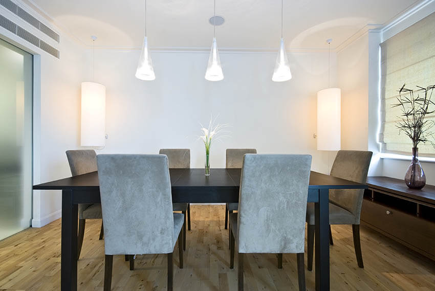 dining room with hanging pendant lights and corner lamps