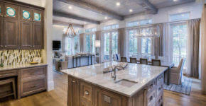 open concept contemporary kitchen with living room dining room and hardwood flooring