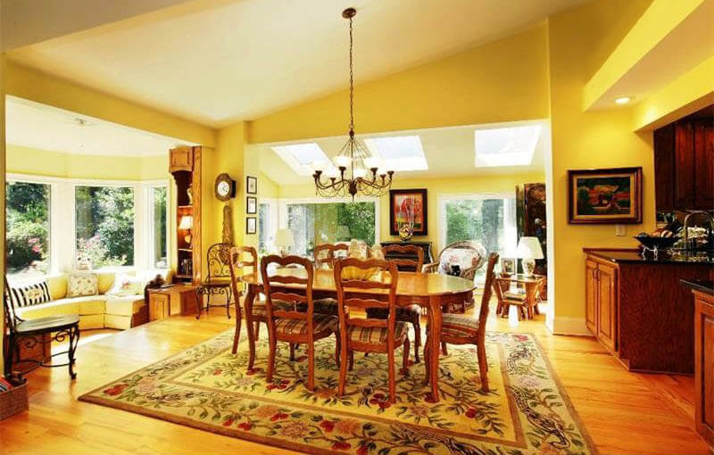 sunny yellow dining room design with wood floors