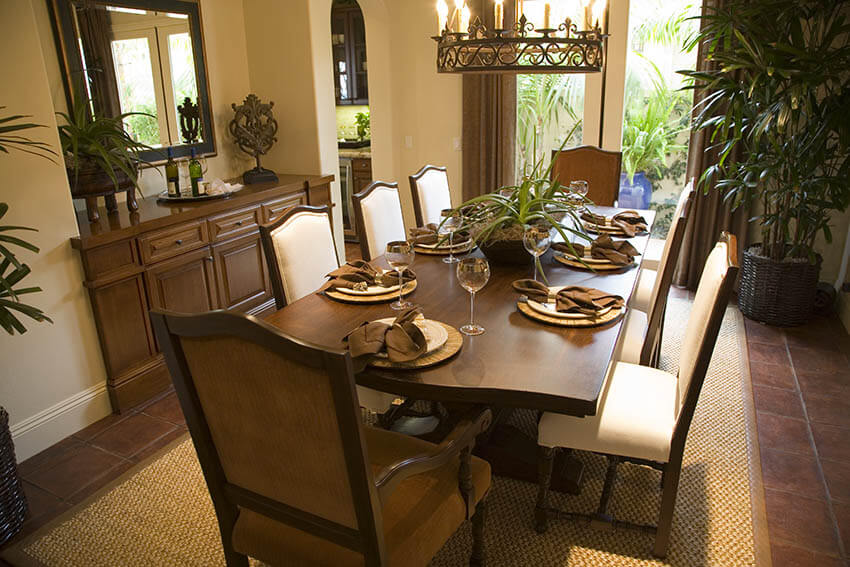 traditional dining room with antique brass ring chandelier