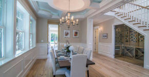 traditional dining room with taupe paint and white wainscoting