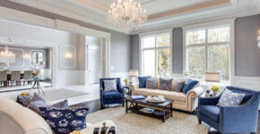 Traditional Luxury Formal Living Room With Tray Ceiling And Glass Chandelier