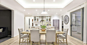 transitional dining room and kitchen with round glass semi circle pendant light